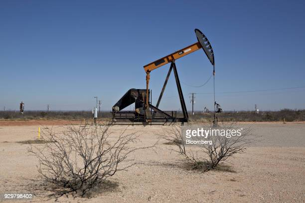 A pumpjack operates on an oil well in the Permian Basin near Crane Texas US on Friday March 2 2018 Chevron the world's thirdlargest publicly traded...