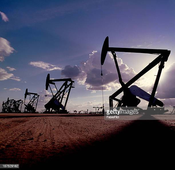 pumpjack silhouette - oil prices stock pictures, royalty-free photos & images