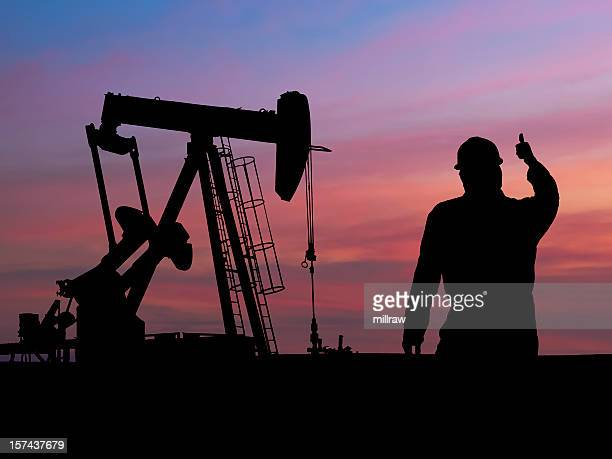 Pumpjack Silhouette with Oil Worker
