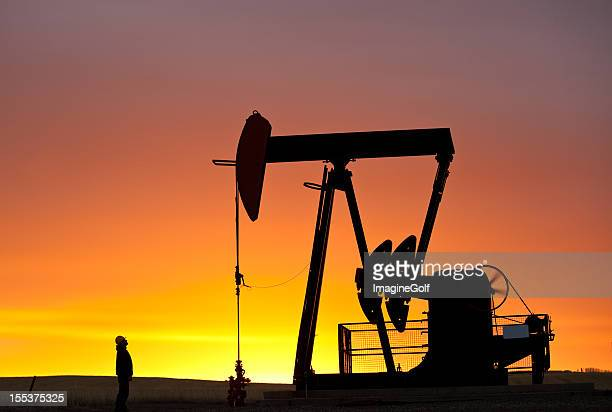 Pumpjack Silhouette With Worker