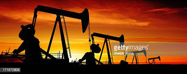 xxxl pumpjack silhouettes - oil stock pictures, royalty-free photos & images
