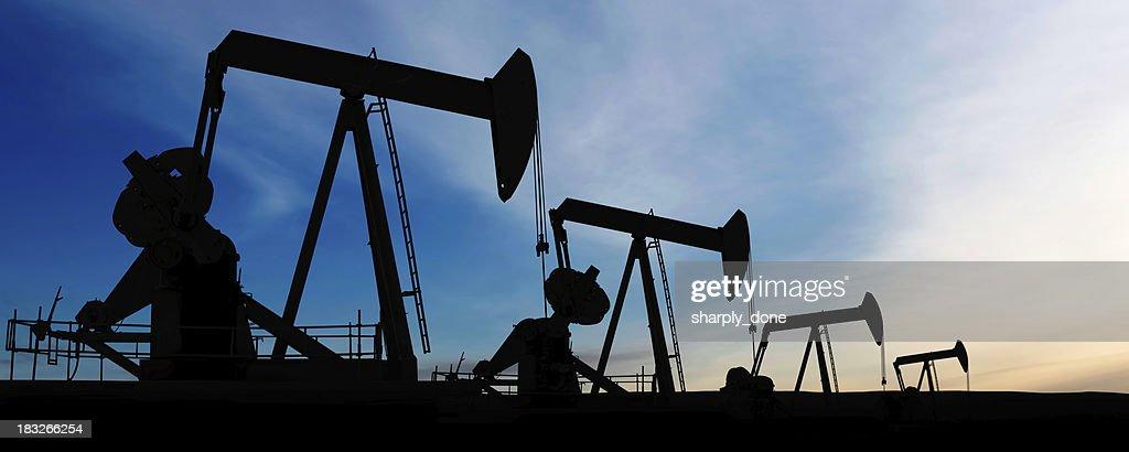 XXXL pumpjack silhouettes : Stock Photo