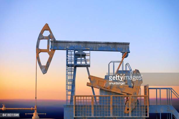 pumpjack silhouettes - oil prices stock pictures, royalty-free photos & images