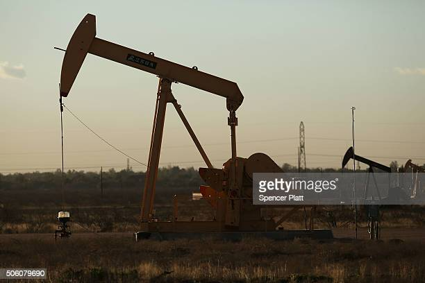A pumpjack sits on the outskirts of town in the Permian Basin oil field on January 21 2016 in the oil town of Midland Texas Despite recent drops in...
