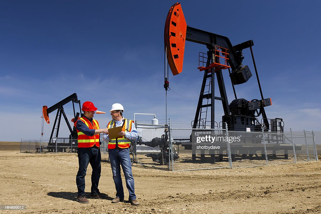 Pumpjacks and Workers : Stock Photo