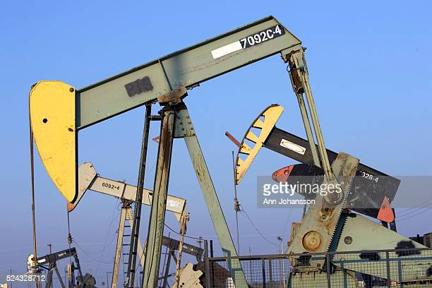 Pumpjacks extract oil from an oil field operated by Aera Energy LLC in Lost Hills, California.