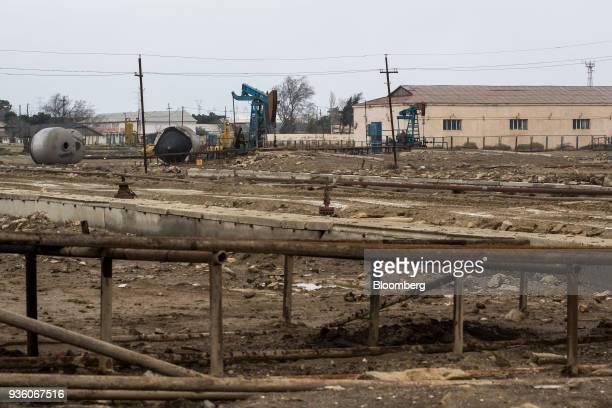 Pumpjacks operate in a field in Baku Azerbaijan on Sunday March 18 2018 Two years after descending into junk Azerbaijan's shortest path to winning...