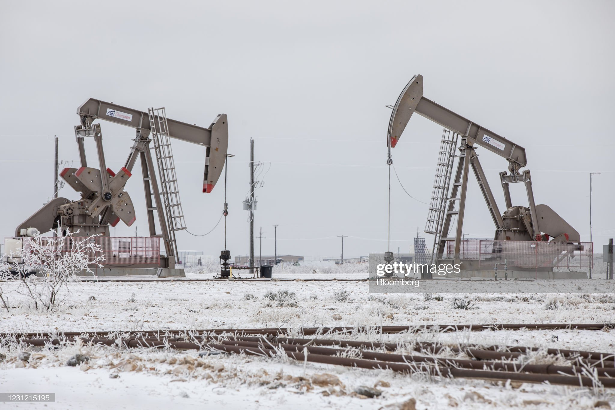 Texas Grid Failed -- Picture of pumpjacks surrounded by snow