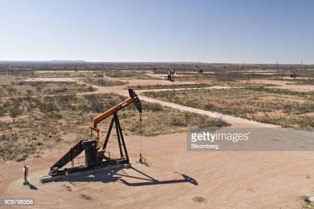 Pumpjacks operate on oil wells in the Permian Basin in this aerial photograph taken over Crane Texas US on Friday March 2 2018 Chevron the world's...