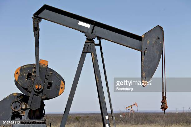 Pumpjacks operate on oil wells in the Permian Basin near Crane Texas US on Friday March 2 2018 Chevron the world's thirdlargest publicly traded oil...