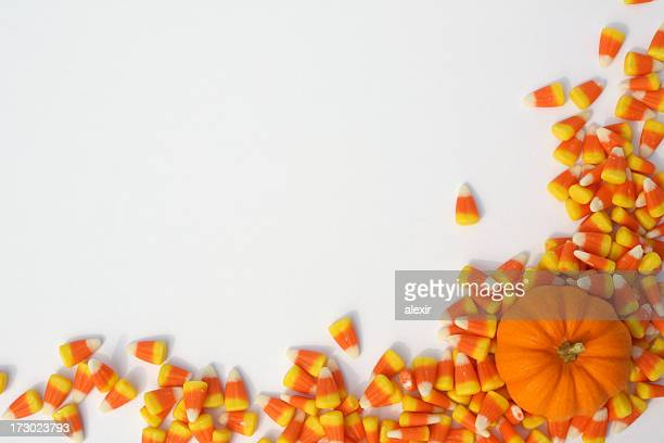 pumpkin and candy corns 1 - candy corn stock photos and pictures