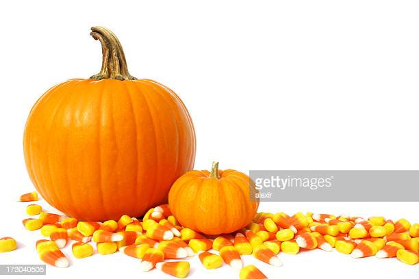 pumpkin and candy corns 2 - candy corn stock photos and pictures