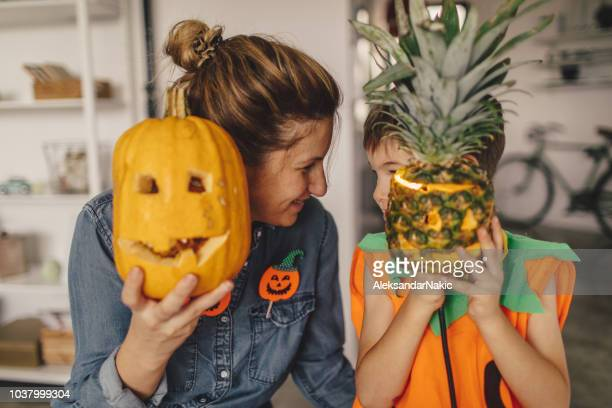 pumpkin and pineapple halloween - southern hemisphere stock photos and pictures