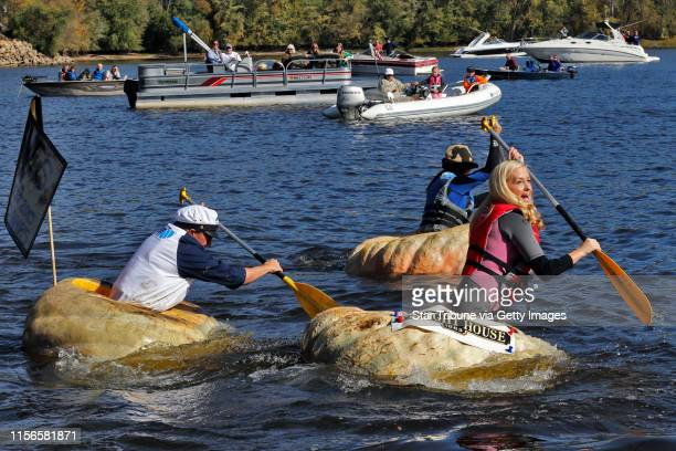 Pumpkin Boat Regatta on the St Croix River in downtown Stillwater as part of Stillwater Harvest Festival Giant pumpkins were hollowed out to allow...