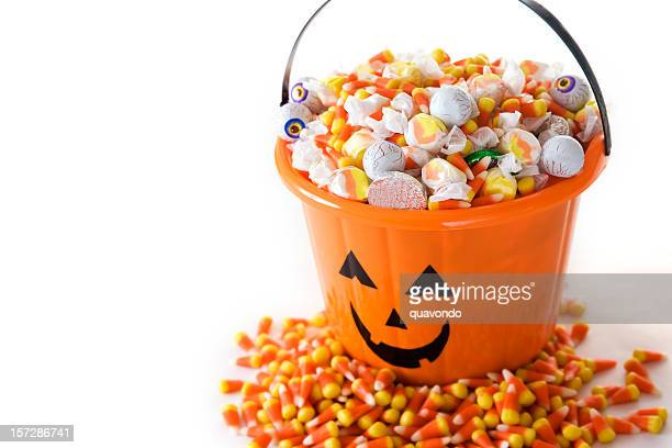 bucket of halloween candy on white, copy space - halloween candy stock photos and pictures