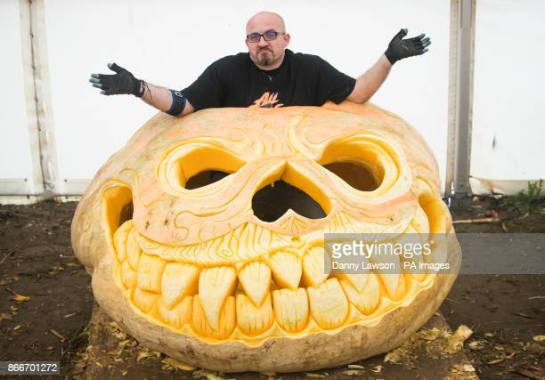 Pumpkin carver Christian Russell with a 'World Record Breaking' Jack OOtilde Lantern carved from a pumpkin weighing 913kg at the York Maze York
