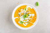 Pumpkin creamy soup served in bowl