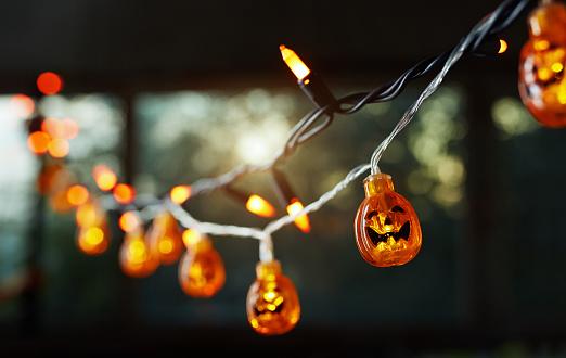 Pumpkin electric light string against the window. Halloween theme - gettyimageskorea