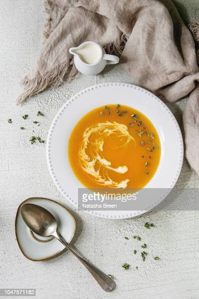 pumpkin or carrot soup - thanksgiving plate of food stock pictures, royalty-free photos & images