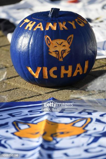 A pumpkin painted blue and carved with the message 'Thank You Vichai' is seen among the tributes gathered outside Leicester City Football Club's King...