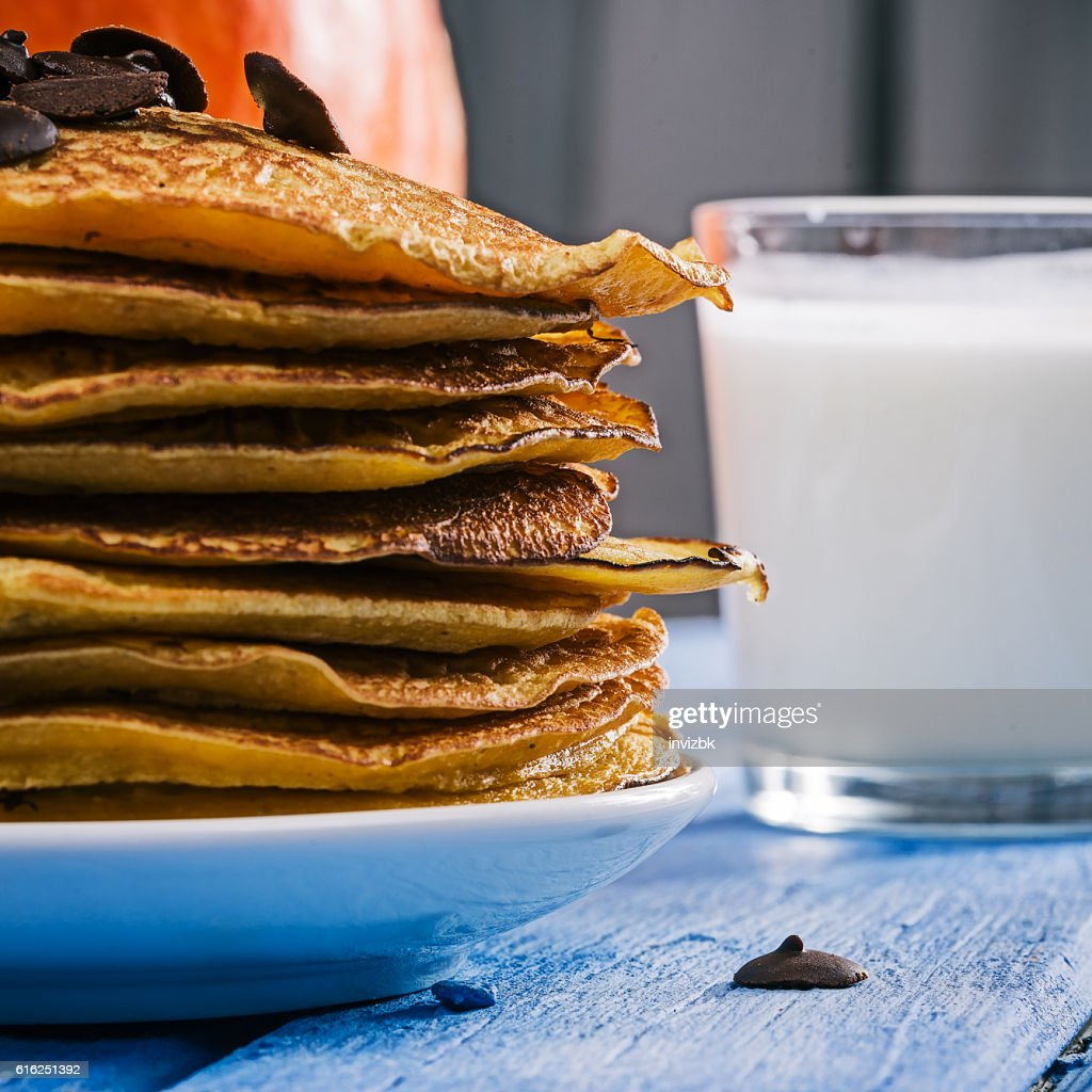 Pumpkin pancakes with chocdrops : Stock Photo