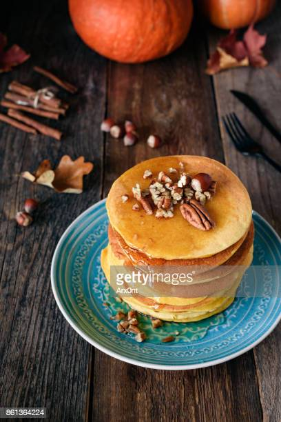 Pumpkin pancakes with pecan nuts and honey
