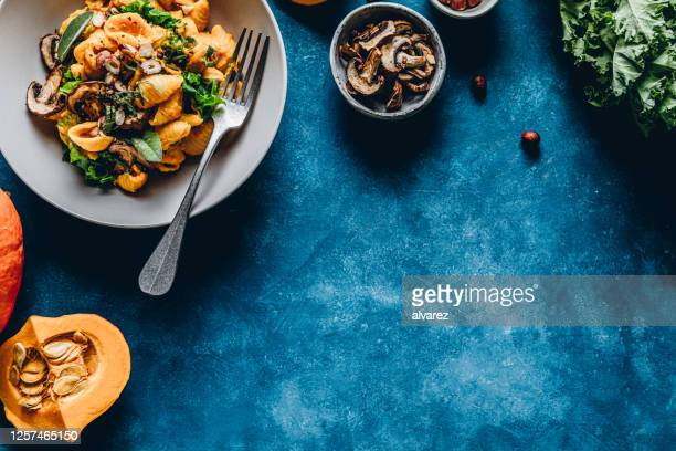 pumpkin pasta with mushroom and hazelnuts - kitchen worktop stock pictures, royalty-free photos & images