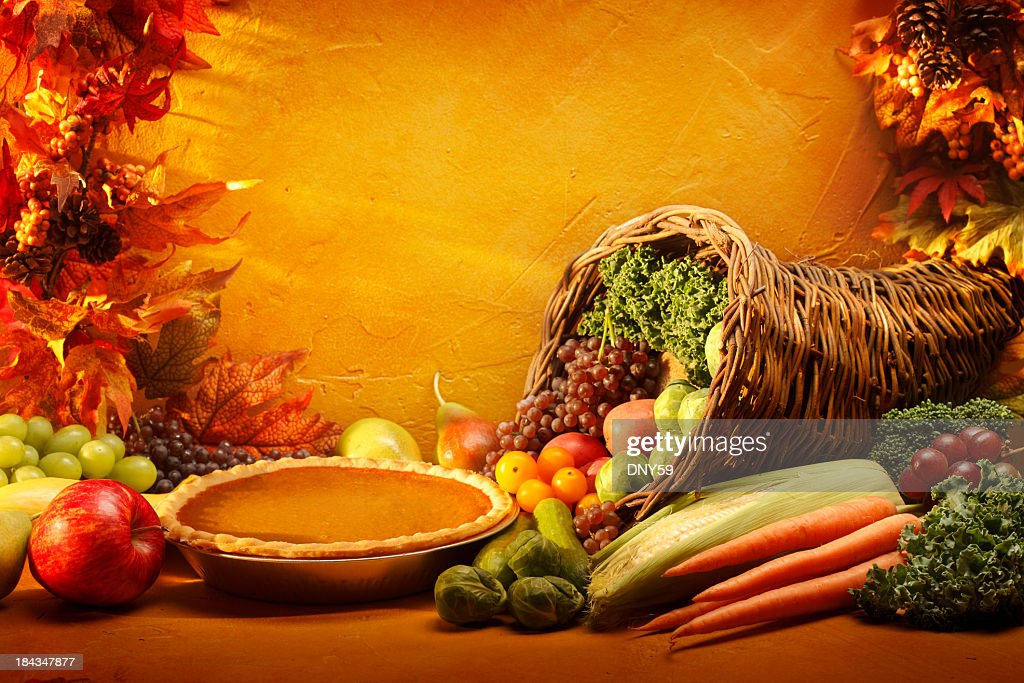 Pumpkin Pie and Cornucopia in an autumn setting : Stock Photo