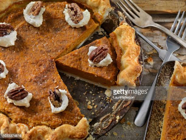 pumpkin pie with candied pecans and whip cream - sweet pie stock pictures, royalty-free photos & images