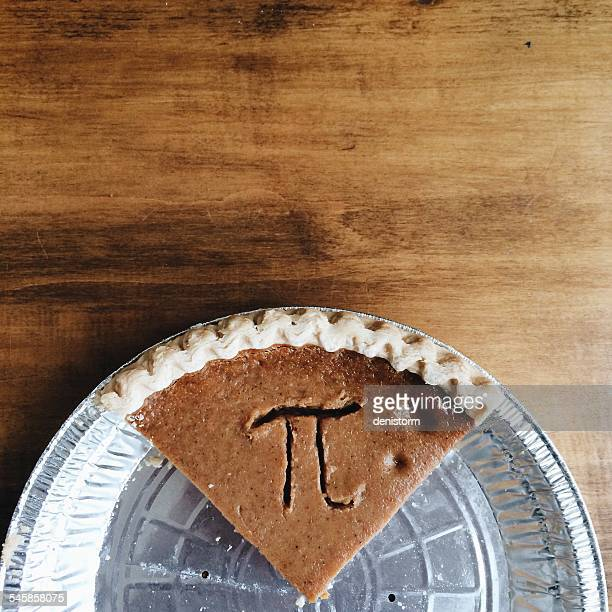 pumpkin pie with pi symbol - pi day stock pictures, royalty-free photos & images