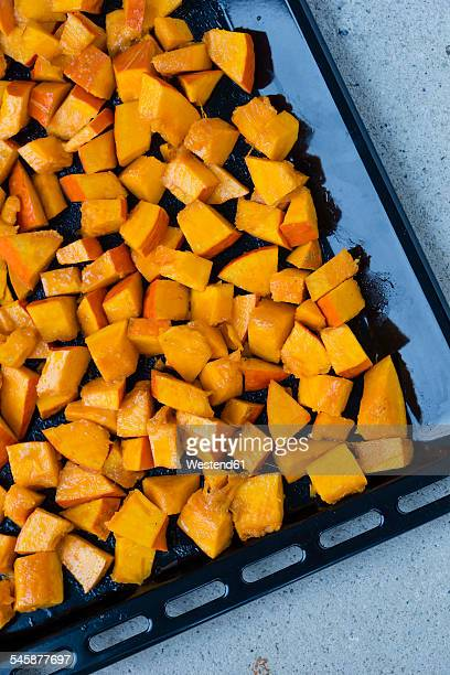 Pumpkin pieces on baking tray