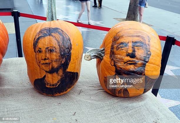 Pumpkin portraits by Disney artist Joseph Yakovetic of Presidential candidates Hillary Clinton and Donald Trump are seen on Hollywood Blvd at...