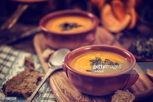 pumpkin soup for autumn days - soup stock pictures, royalty-free photos & images
