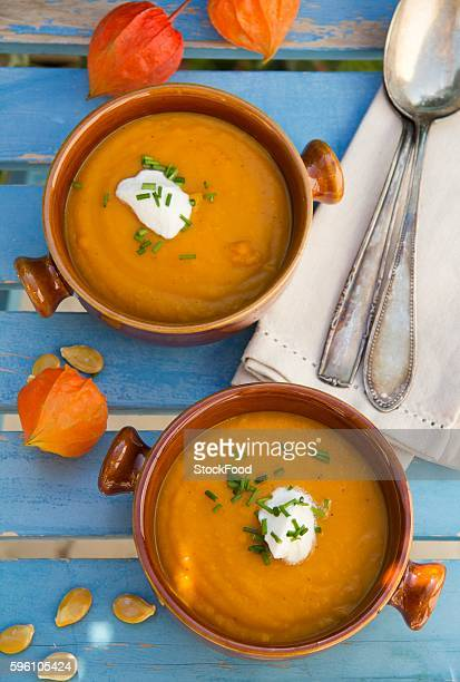 Pumpkin soup with chives and a blob of sour cream