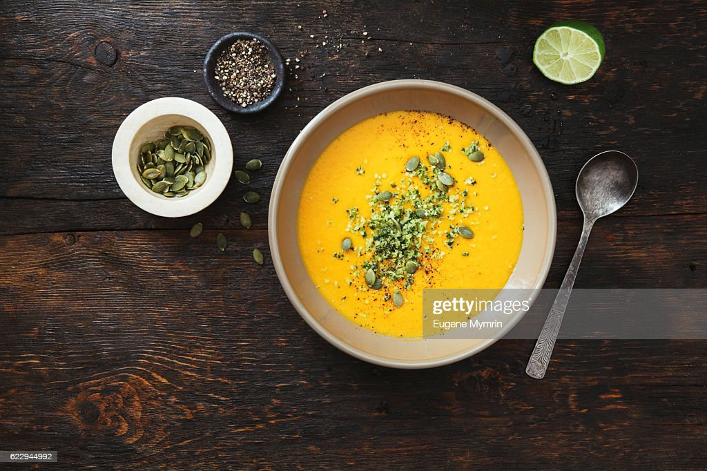 Pumpkin soup with coconut and seeds : Stock-Foto