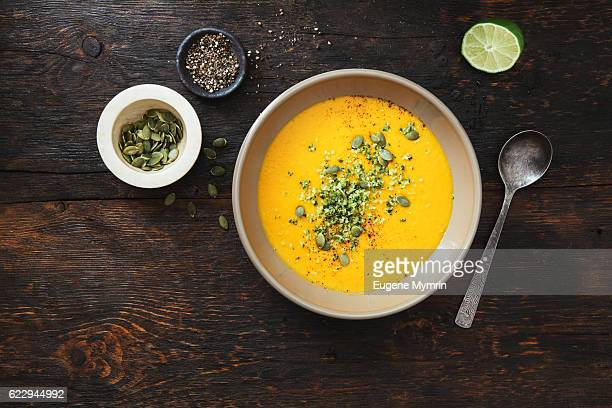 pumpkin soup with coconut and seeds - pureed stock photos and pictures