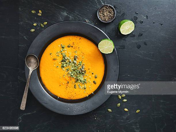 pumpkin soup with coconut and seeds - pureed stock pictures, royalty-free photos & images