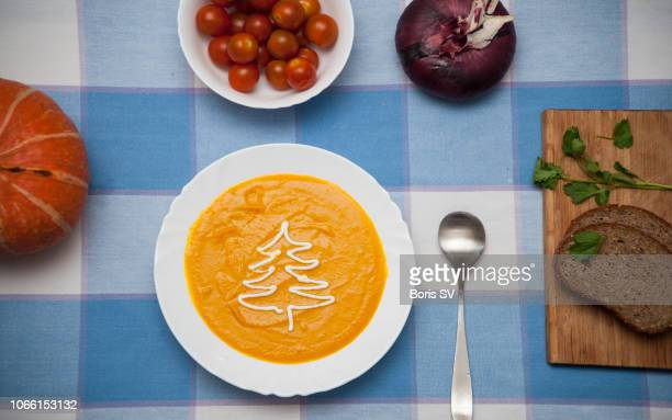 pumpkin soup with cream drawn as christmas tree - appetiser stock photos and pictures