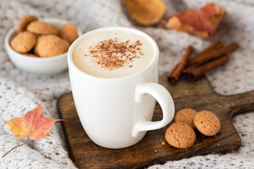 Pumpkin spice latte or cappucino and cookies - gettyimageskorea