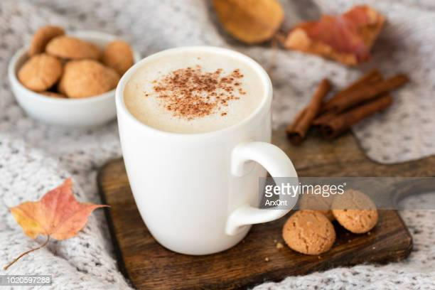 pumpkin spice latte or cappucino and cookies - latte stock pictures, royalty-free photos & images
