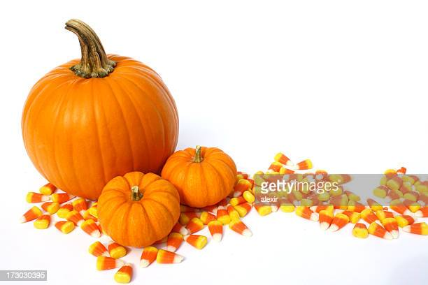 pumpkins and candy corns 3 - candy corn stock photos and pictures