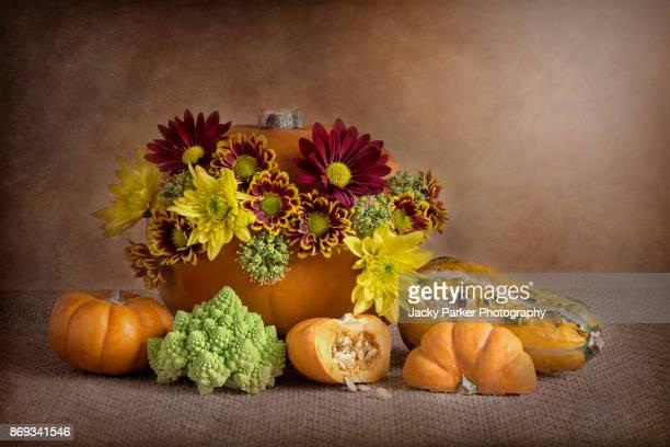Pumpkins and Flowers still-life display