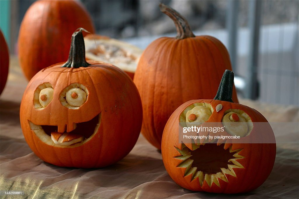 Pumpkins decorated with faces with eyes and mouths : Stock Photo