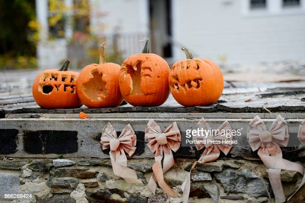 Pumpkins on the foundation at the lot on Noyes St in Portland where six young adults perished after a fire engulfed a duplex in 2014 Tuesday October...