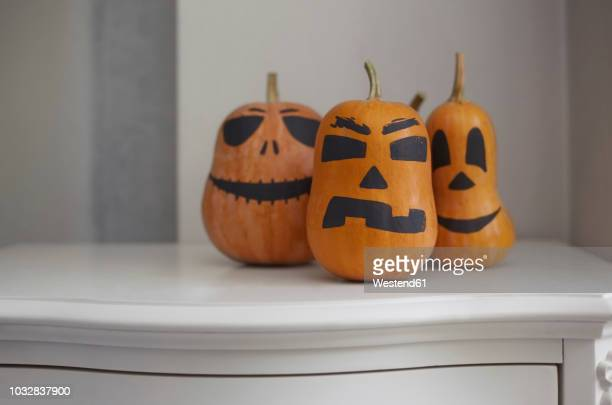 pumpkins painted for halloween - scary pumpkin faces stock photos and pictures