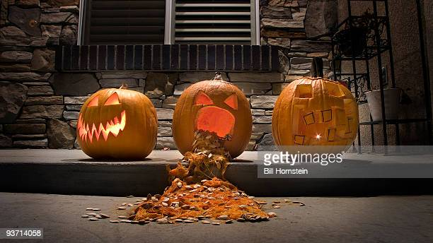 pumpkins - scary pumpkin faces stock photos and pictures