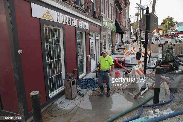 Pumps are used to try to stay ahead of creeping floodwater from the Mississippi River as it seeps into the historic downtown area on May 31 2019 in...