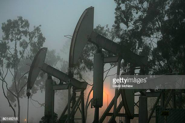 Pumps draw petroleum from oil wells before dawn as the cost of crude oil tops $104 per barrel in its surge to new record high prices March 6 2008 in...