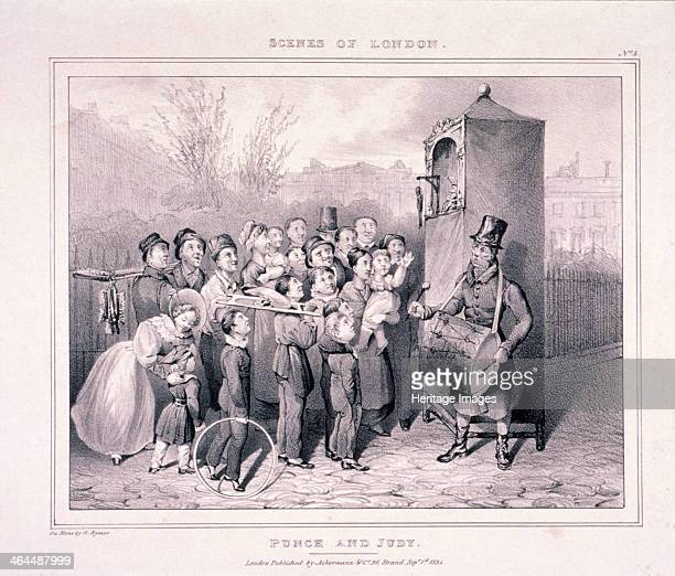 'Punch and Judy' 1834 Plate no4 from London Scenes view of a group of children and adults watching a Punch and Judy Show A man dressed in long coat...