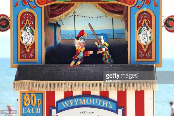 Punch and Judy puppets battle it out during a show on Weymouth beach on July 23 2008 in Weymouth England With the majority of schools breaking up...
